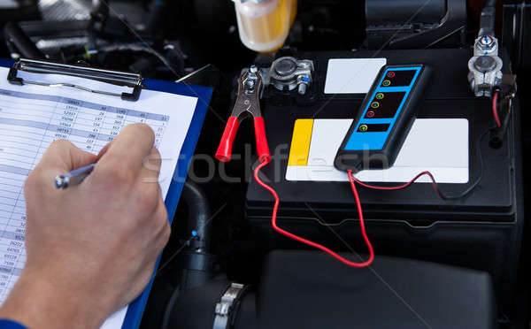 Hand Writing On Clipboard With Pliers Connected To Multimeter Stock photo © AndreyPopov