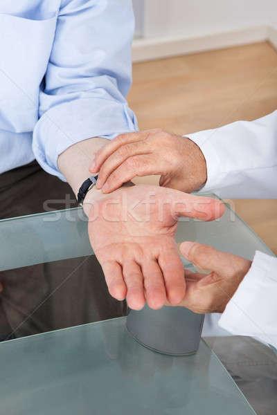 Orvos elvesz idős pulzus kép asztal Stock fotó © AndreyPopov
