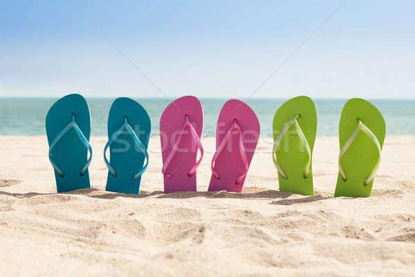 Pairs Of Flip-flops On Beach Stock photo © AndreyPopov