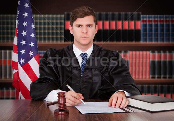 Maschio giudice seduta ritratto giovani Foto d'archivio © AndreyPopov