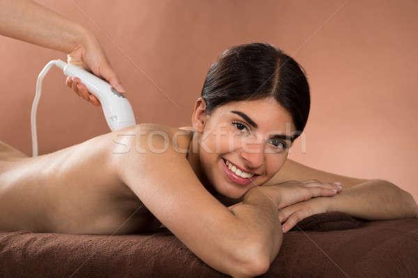 Mutlu kadın lazer tedavi Stok fotoğraf © AndreyPopov