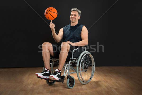 Handicapées balle fauteuil roulant doigt heureux Photo stock © AndreyPopov