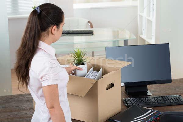 Businesswoman Packing Belongings In Cardboard Box Stock photo © AndreyPopov