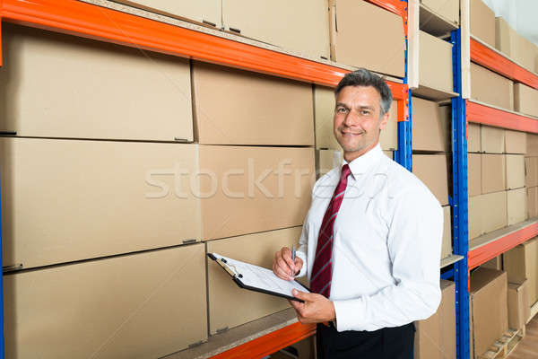 Manager With Clipboard In Distribution Warehouse Stock photo © AndreyPopov