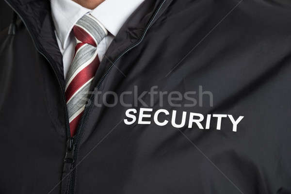 Security Guard Wearing Uniform With The Text Security Stock photo © AndreyPopov