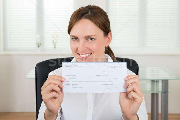 Femme d'affaires chèque portrait heureux bureau Photo stock © AndreyPopov
