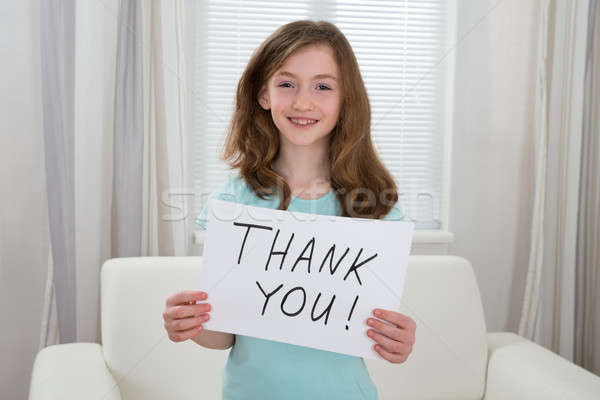 Girl Holding Board With The Text Thank You Stock photo © AndreyPopov