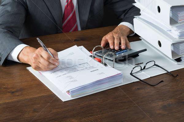 ビジネスマン デスク 成熟した 電卓 紙 男 ストックフォト © AndreyPopov