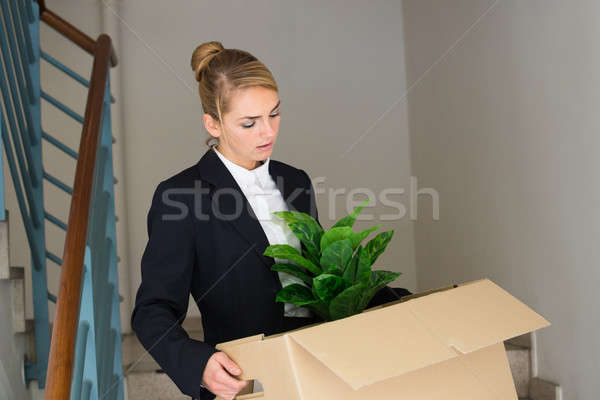Businesswoman Carrying Her Belongings At Office Stock photo © AndreyPopov