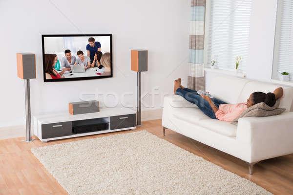Nő tv nézés kanapé fiatal afrikai otthon Stock fotó © AndreyPopov