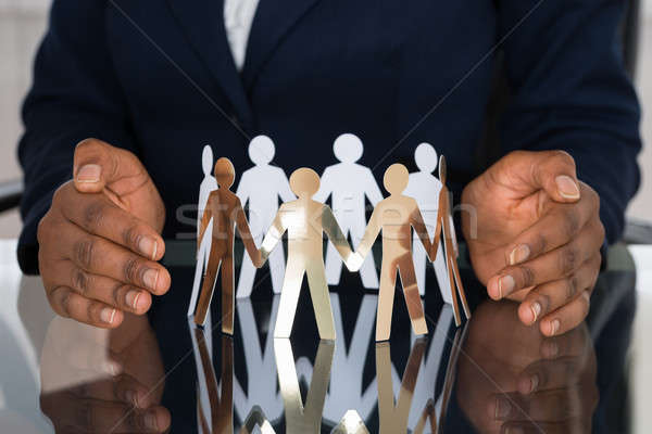 Human Hand Protecting Cut-out Figures Stock photo © AndreyPopov
