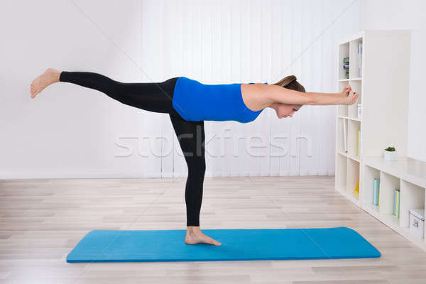 Female Doing Yoga In Her Living Room Stock photo © AndreyPopov