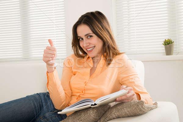 Boldog nő tart napló ül kanapé Stock fotó © AndreyPopov