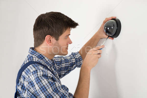 Technician Installing Surveillance Camera Stock photo © AndreyPopov