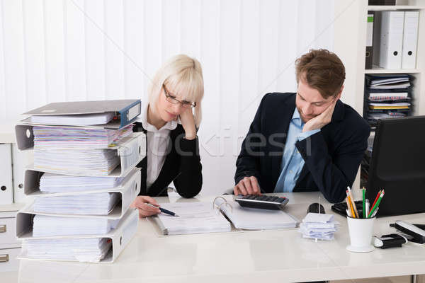 Businesspeople Calculating Invoices Stock photo © AndreyPopov