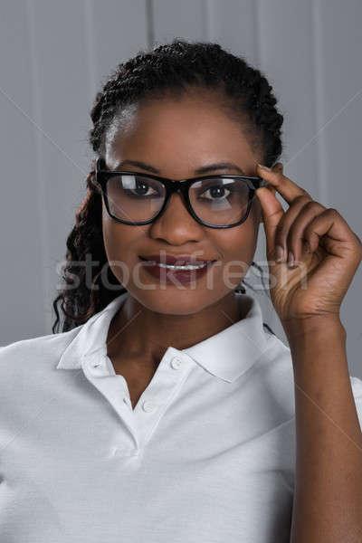 Szczęśliwy kobieta okulary portret piękna Zdjęcia stock © AndreyPopov