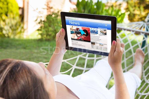 Nő függőágy olvas hírek közelkép digitális Stock fotó © AndreyPopov