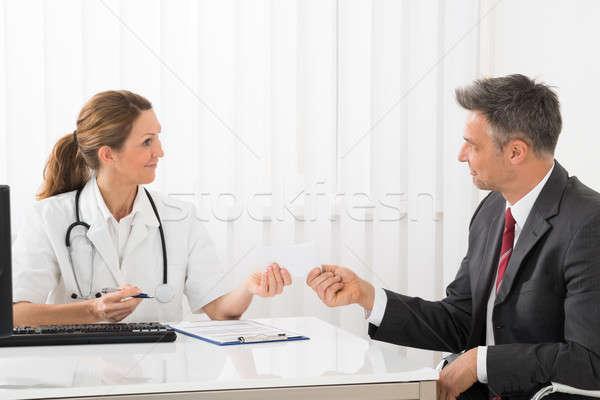 Medico prescrizione imprenditore femminile carta maturo Foto d'archivio © AndreyPopov