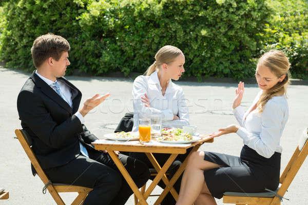 Grupo três argumento jovem restaurante Foto stock © AndreyPopov