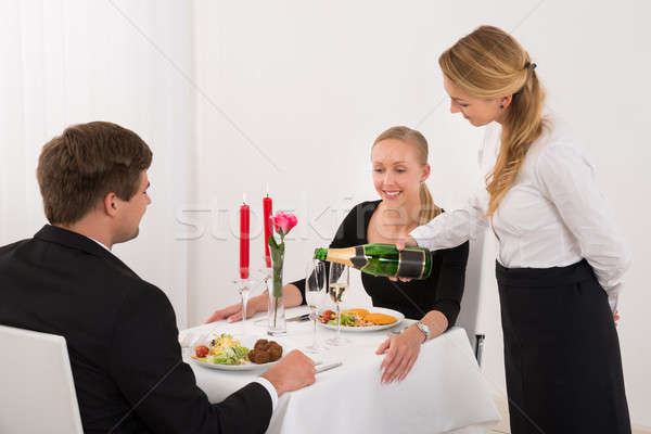 Feminino garçonete champanhe vidro casal Foto stock © AndreyPopov