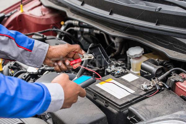 Mechanic Hands Using Multimeter For Checking Battery Stock photo © AndreyPopov