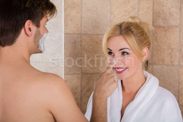 Man Putting Shaving Foam On Woman Nose Stock photo © AndreyPopov