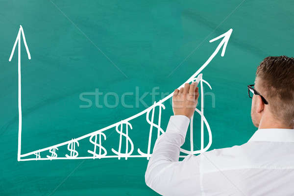 Businessman Drawing Increasing Dollar Graph Stock photo © AndreyPopov