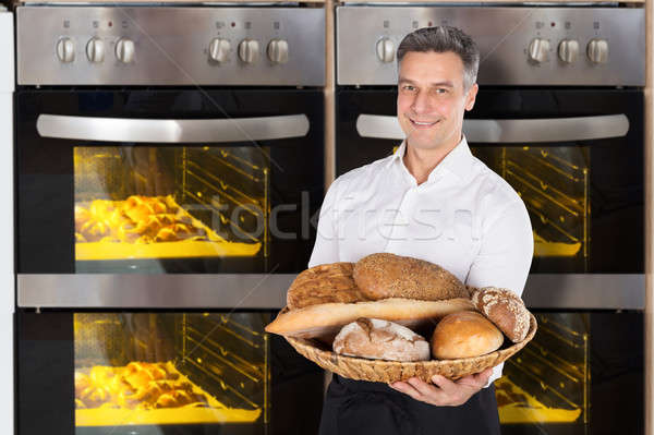 Chef Holding A Wicker Basket Full Of Bread Stock photo © AndreyPopov