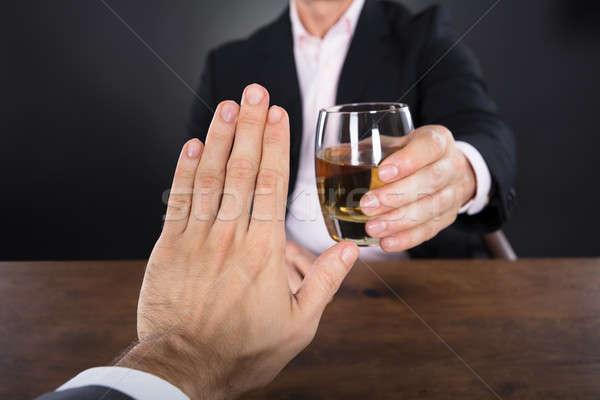 Biznesmen strony szkła whisky wina tle Zdjęcia stock © AndreyPopov