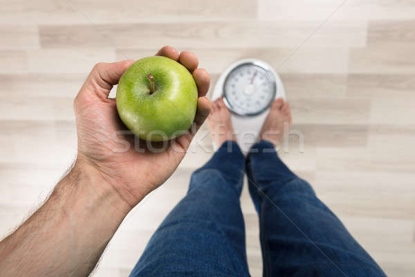 Person Measuring Weight On Weighing Machine Stock photo © AndreyPopov