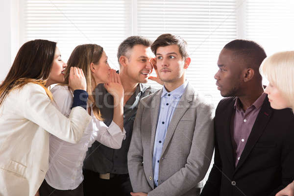 Business Colleagues Whispering In The Office Stock photo © AndreyPopov