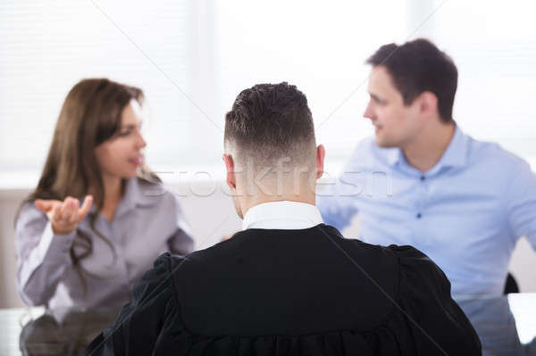 Couple Quarreling In Front Of Judge Stock photo © AndreyPopov