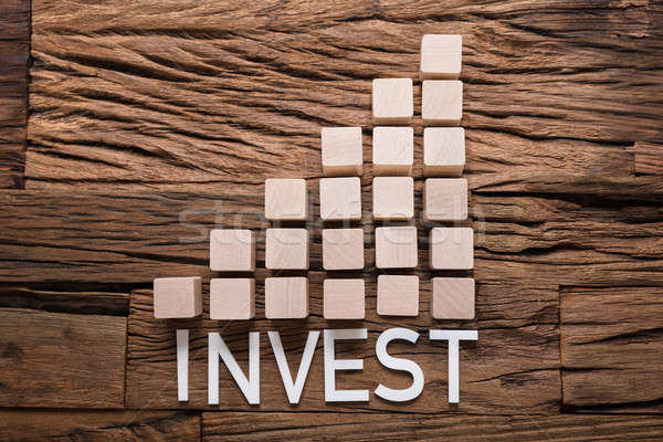 Invest Text By Increasing Bar Graph Blocks On Wood Stock photo © AndreyPopov
