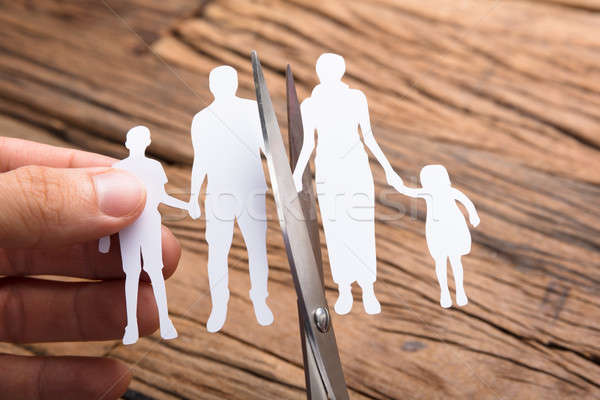 Hand Cutting Paper Family Over Wooden Table Stock photo © AndreyPopov