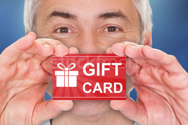 Hombre tarjeta de regalo primer plano altos rojo Foto stock © AndreyPopov