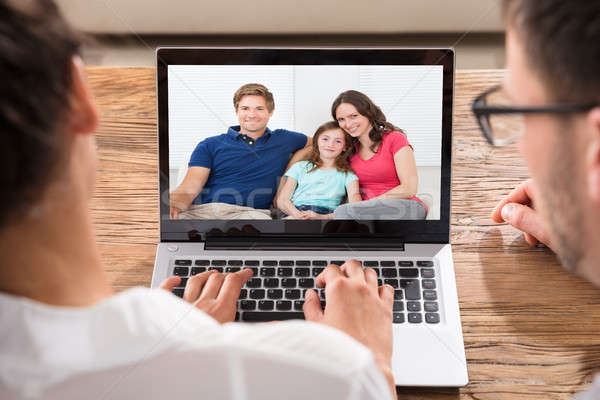 Két személy videó család közelkép laptop asztal Stock fotó © AndreyPopov