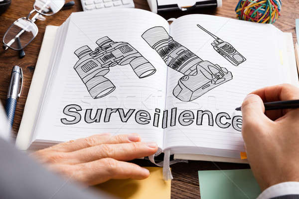 Person Drawing Surveillance Equipments In Book Stock photo © AndreyPopov