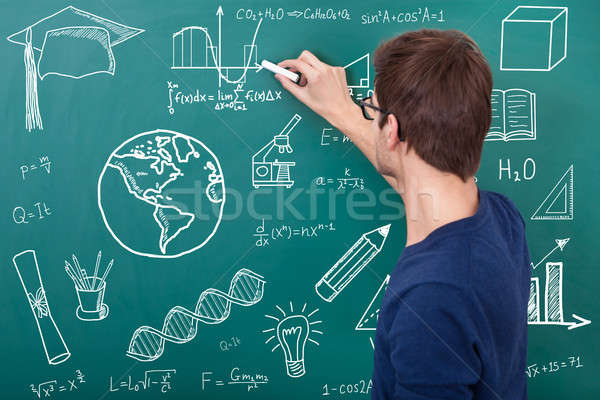 Teacher Teaching Physic Equation In Classroom Stock photo © AndreyPopov