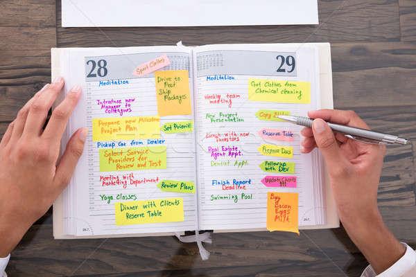 üzletasszony készít terv napló közelkép munkahely Stock fotó © AndreyPopov