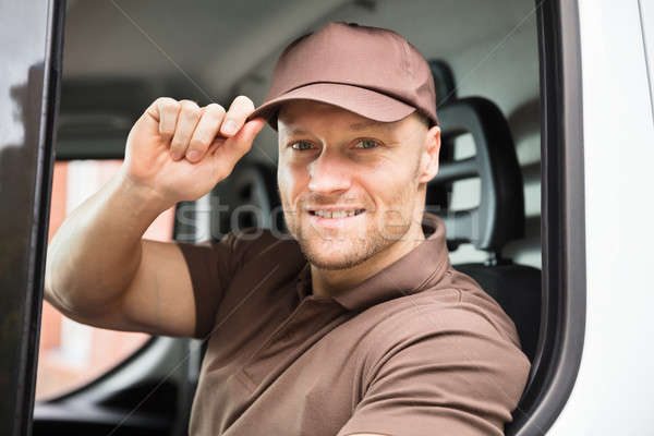 Happy Delivery Man Sitting Inside Van Stock photo © AndreyPopov