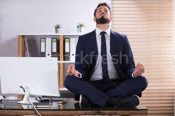 Imprenditore meditazione ufficio giovani seduta desk Foto d'archivio © AndreyPopov