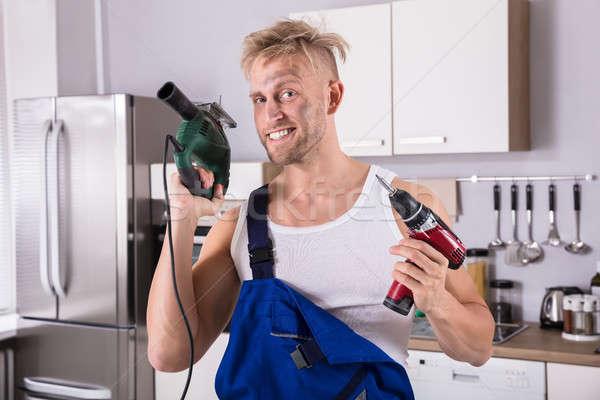 Technikus tart elektromos fúró csavarhúzó portré Stock fotó © AndreyPopov