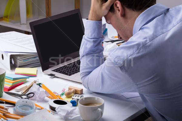 Stressful Businessman With Laptop At Workplace Stock photo © AndreyPopov