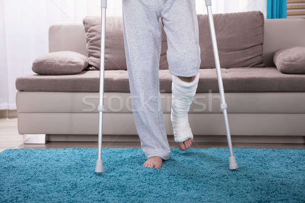 Man With Broken Leg Walking On Carpet Stock photo © AndreyPopov