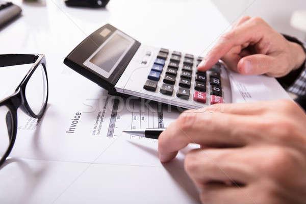 Ręce rachunek Kalkulator okulary biurko Zdjęcia stock © AndreyPopov