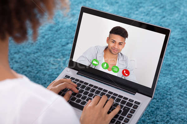 Woman Video Conferencing With Friend On Laptop Stock photo © AndreyPopov