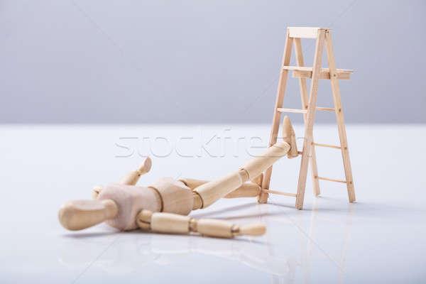 Wooden Figure Lying On Floor Stock photo © AndreyPopov