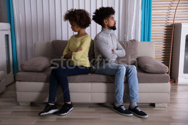 Unhappy Couple Sitting Back To Back On Sofa Stock photo © AndreyPopov