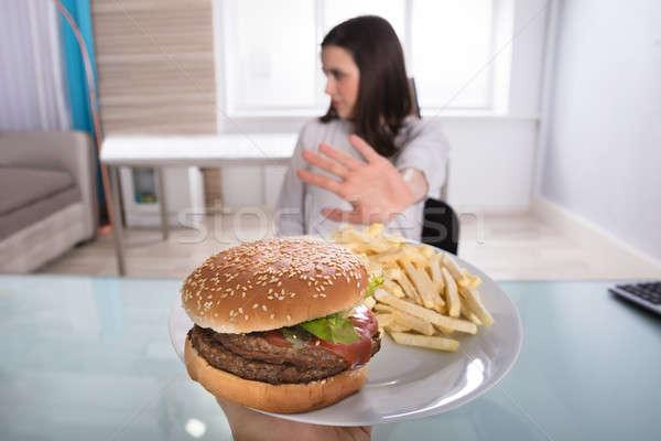 Kadın sağlıksız gıda genç kadın Burger patates kızartması plaka Stok fotoğraf © AndreyPopov