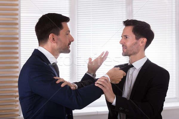 Enojado empresario socios empate vista lateral Foto stock © AndreyPopov